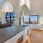 Clock-Tower-Apartment-open-plan-kitchen-island-in-high-gloss-white-with-range