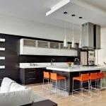 Minimalist-kitchen-with-black-with-bright-orange-counter-stools