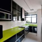 Wonderful-Apartment-Interior-By-Brunete-Fraccaroli-With-glossy-black-and-green-kitchen-island-sink-oven-stove-cabinet-window-and-flower-ornament