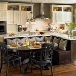 kitchen-island_beautiful-looking-small-kitchen-island-design_kitchen-cabinets_stainless-steel-convection-oven_white-three-light-chandeliers_brown-hardwood-floor_black-wooden-chairs-sofa-jpeg