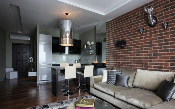 Интерьер кухни, совмещенной с гостиной и столовой, в стиле лофт